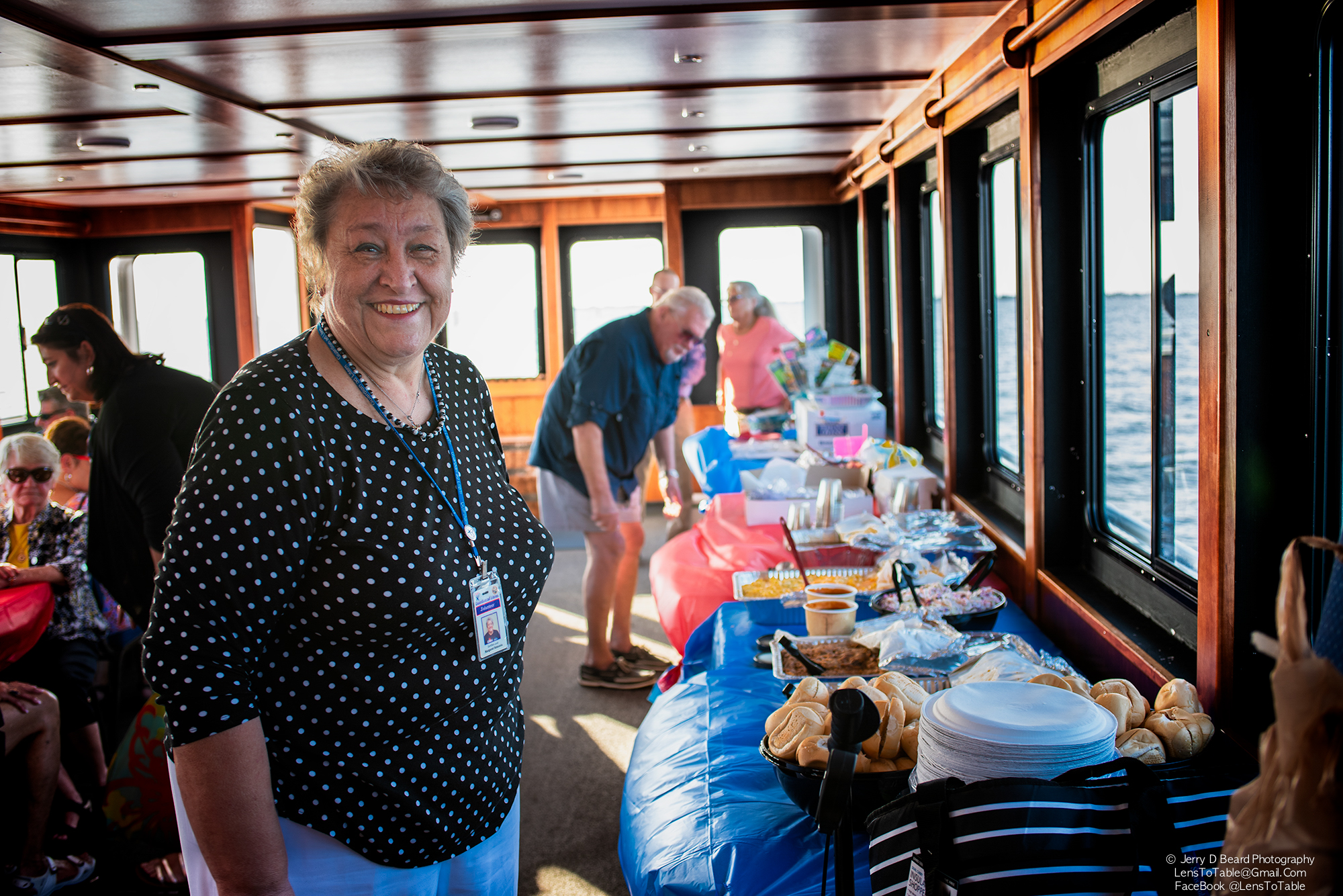 """Guardian Ad Litem volunteer Margaret Szmania arranges a buffet meal that she had catered, onboard the """"Charlotte Lady"""", at the GAL Sunset Cruise, at Fishermans Village, in Punta Gorda, on Wednesday, April 24, 2019."""