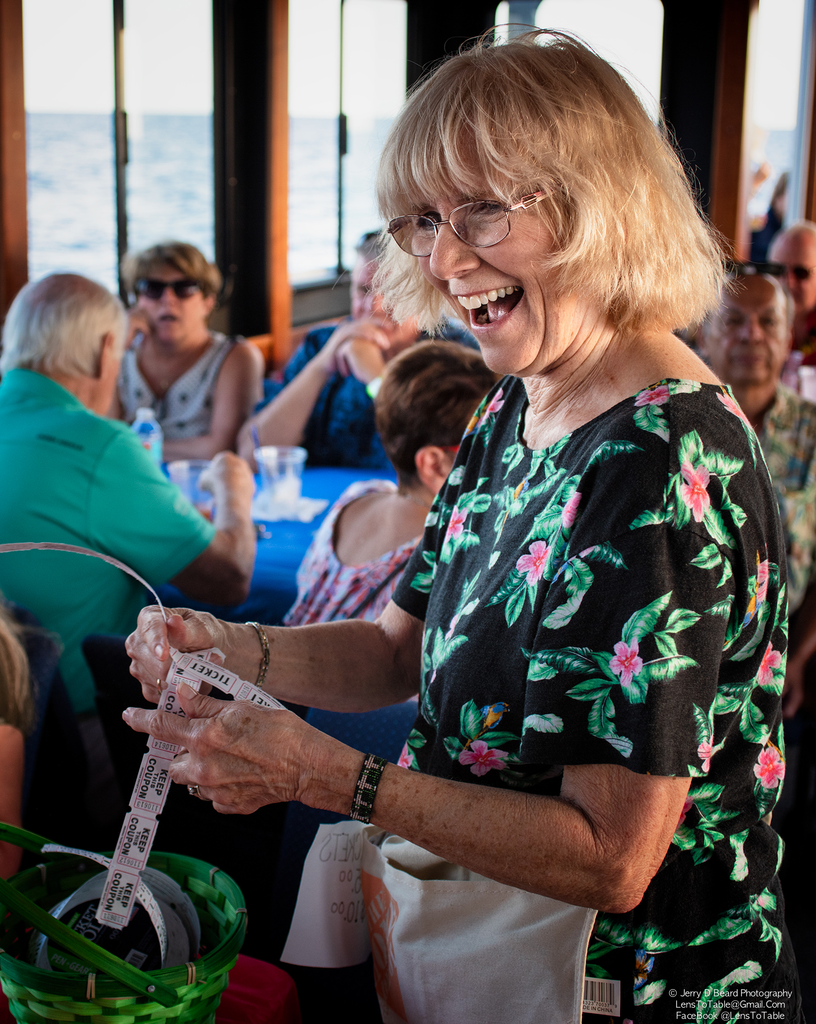 """Guardian Ad Litem Volunteer Cheryl Lehew sells raffle tickets, onboard the """"Charlotte Lady"""", at the GAL Sunset Cruise, at Fishermans Village, in Punta Gorda, on Wednesday, April 24, 2019."""