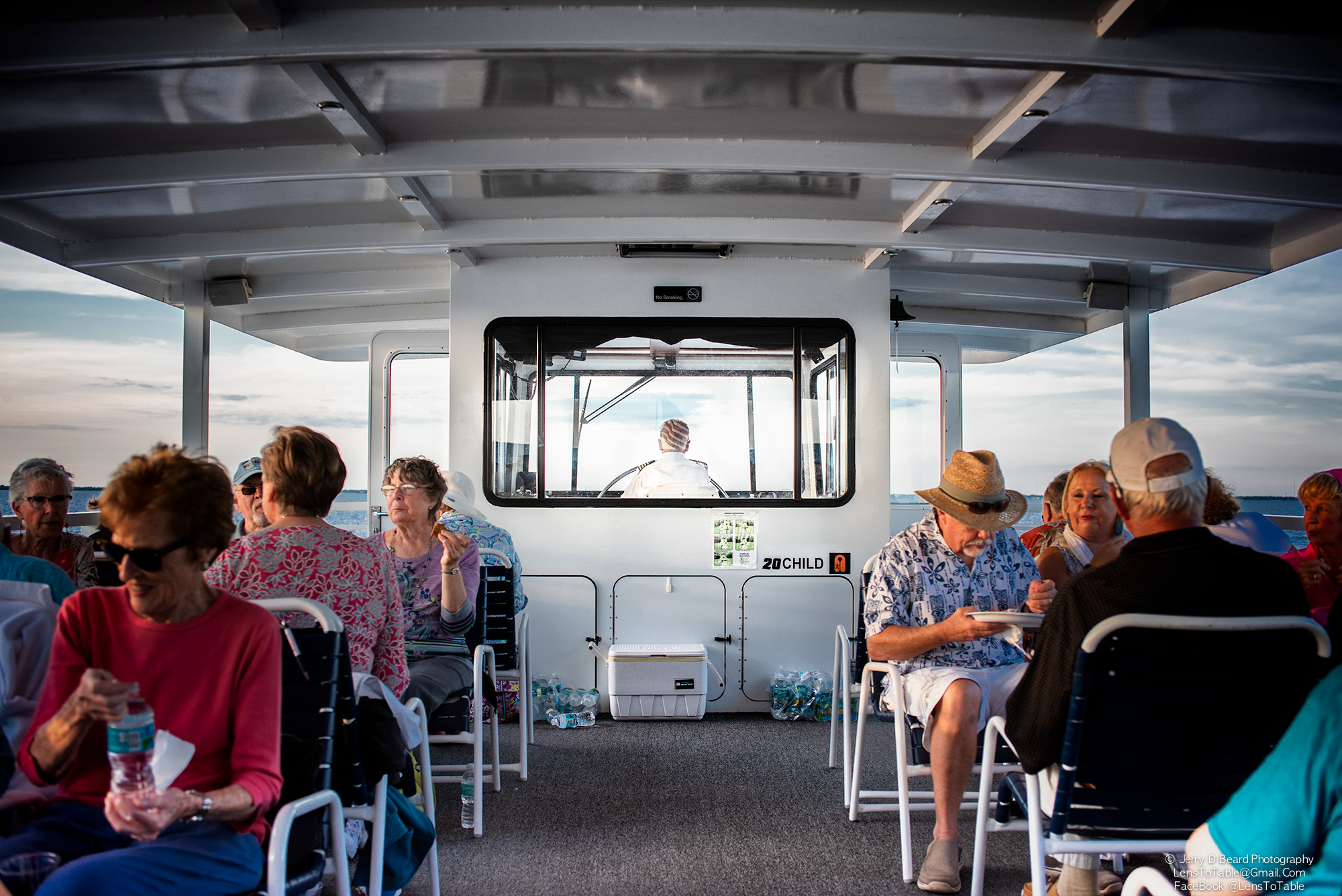 """Captain Joe Giulivo steers the 'Charlotte Lady"""", at the GAL Sunset Cruise, at Fishermans Village, in Punta Gorda, on Wednesday, April 24, 2019."""
