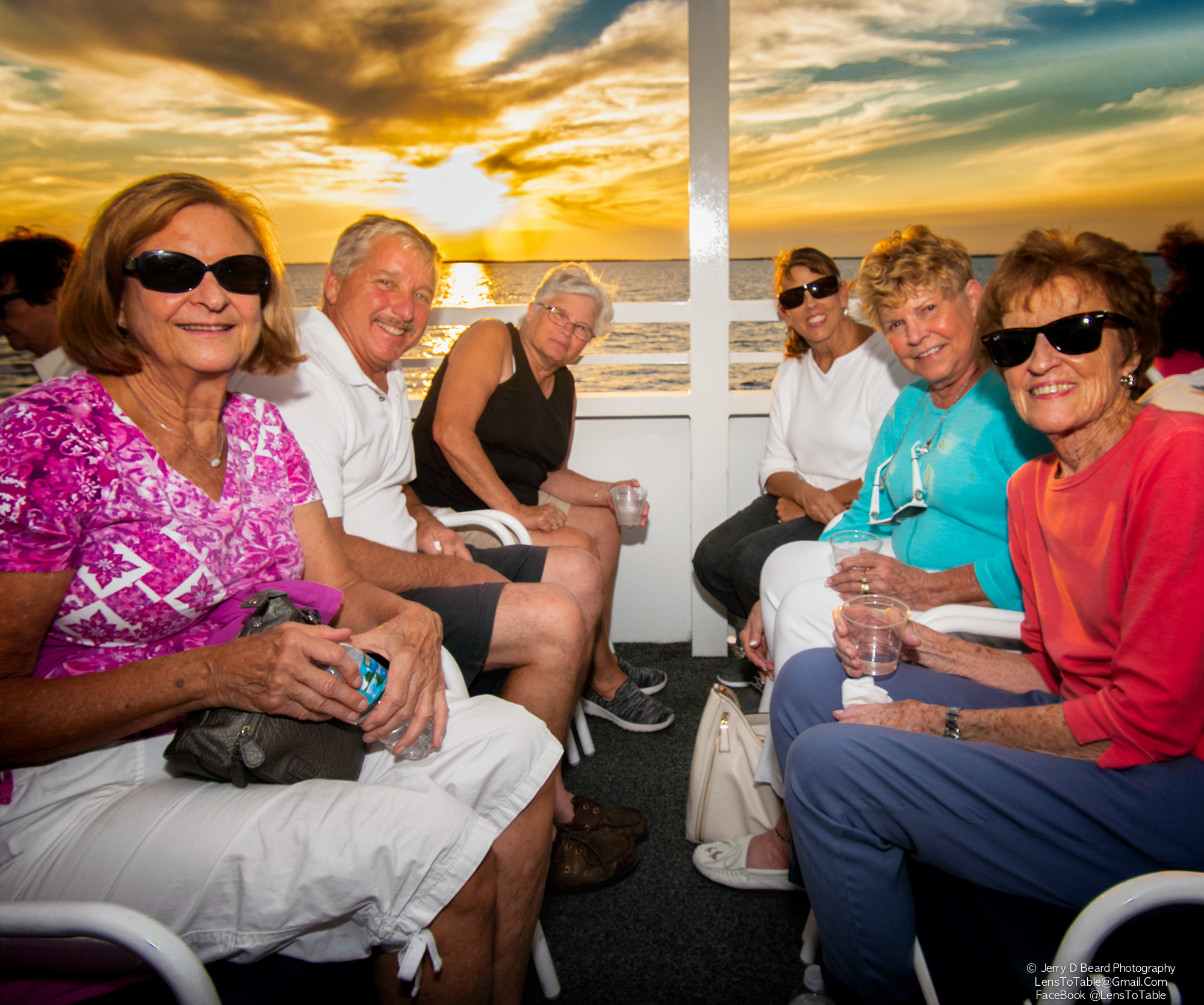 """A group of friends poses for a photo, onboard the """"Charlotte Lady"""", at the GAL Sunset Cruise, at Fishermans Village, in Punta Gorda, on Wednesday, April 24, 2019. Clockwise from left: John Langenberg, Darrell Ebert, Linda Ebert, Betty Langenberg, Penny Crock, and Jeane Arsenault."""