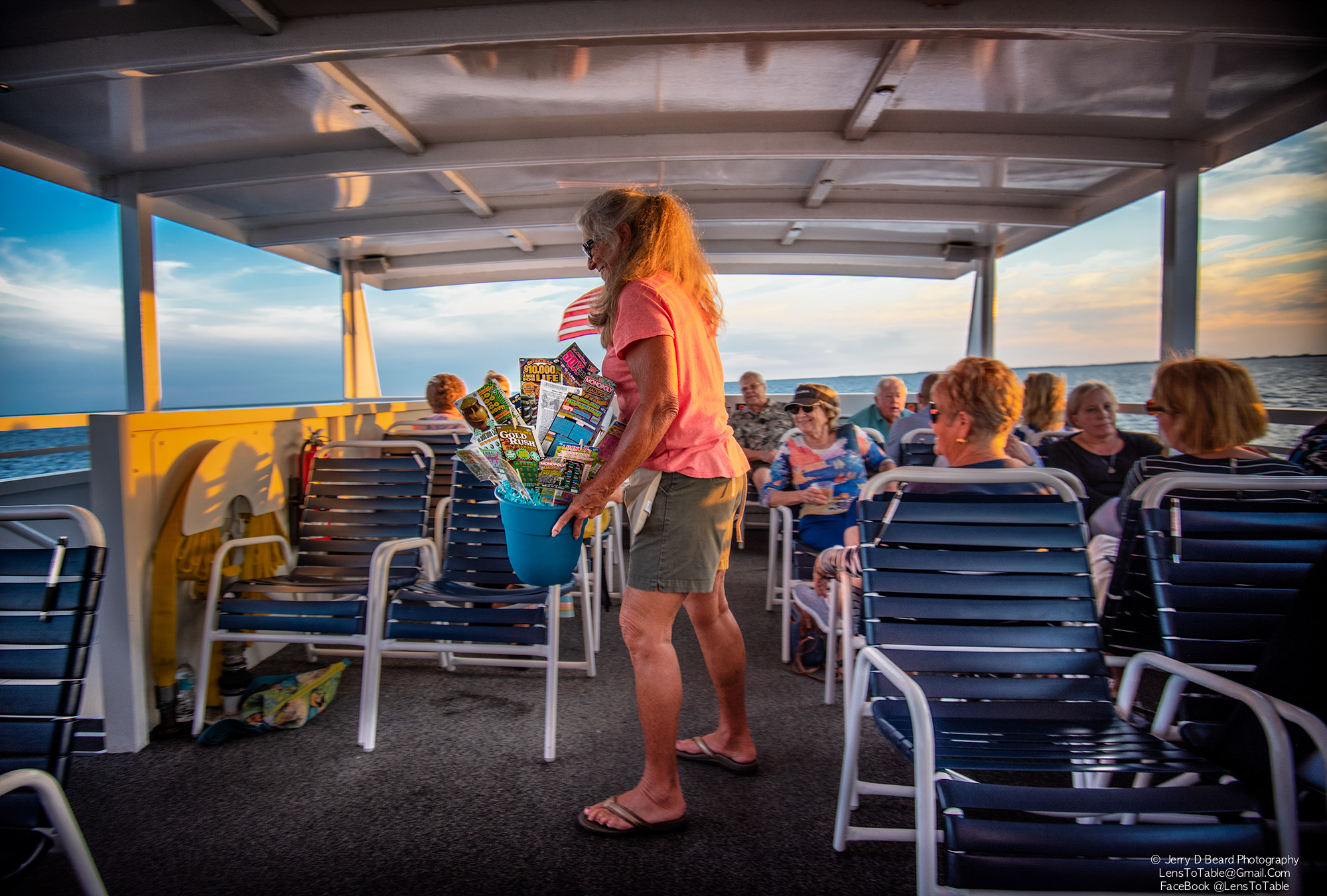 """Guardian Ad Litem Volunteer Angie Sweetnam sells tickets for the Lottery Ticket Tree, onboard the """"Charlotte Lady"""", at the GAL Sunset Cruise, at Fishermans Village, in Punta Gorda, on Wednesday, April 24, 2019."""