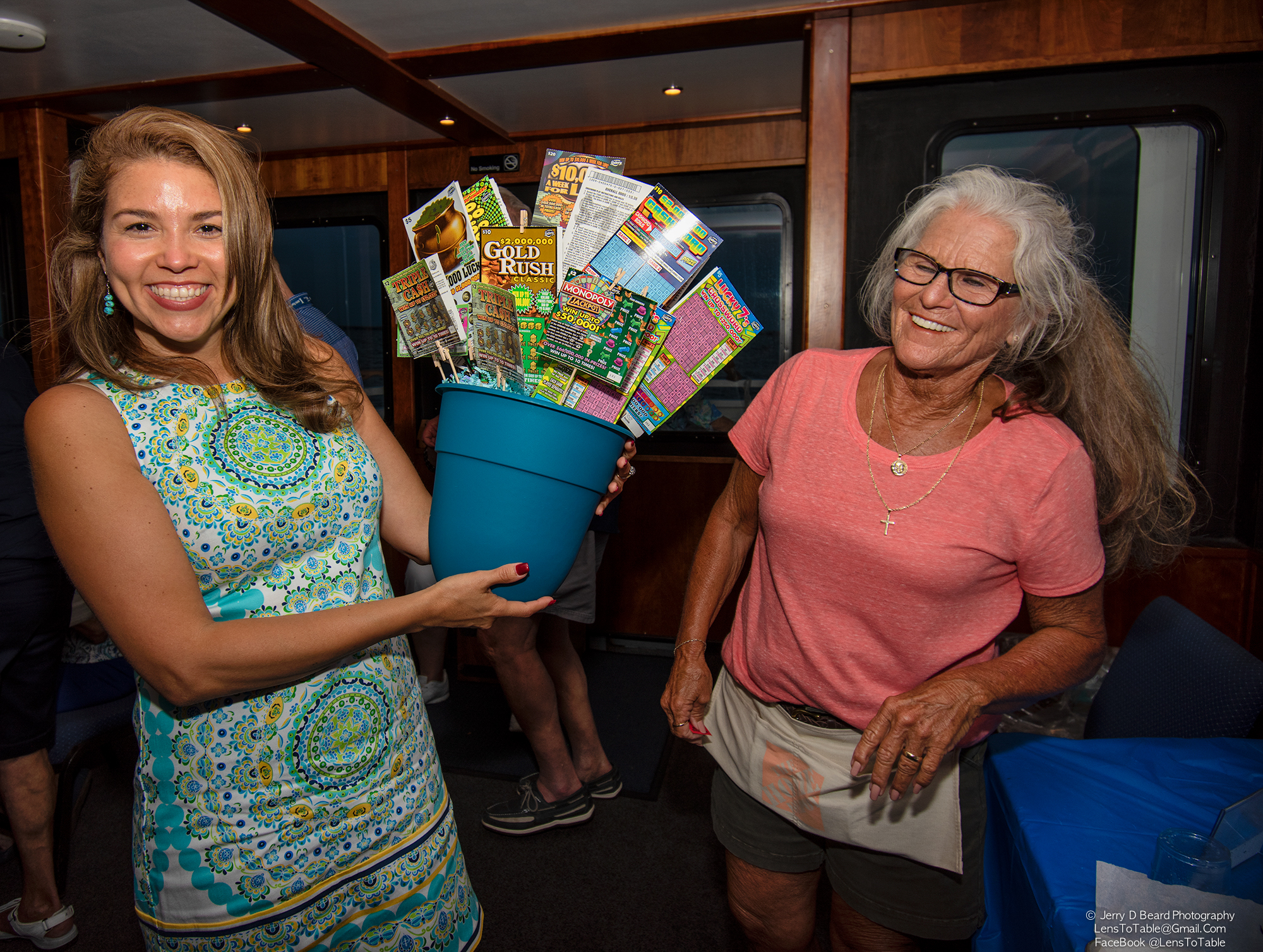 """Lottery Tree winner, Six-Year Guardian Ad Litem Volunteer Carolina Zurbrigen, poses for a photo, onboard the """"Charlotte Lady"""", at the GAL Sunset Cruise, at Fishermans Village, in Punta Gorda, on Wednesday, April 24, 2019."""